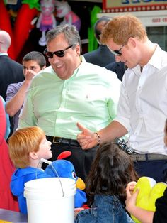 HRH Prince Harry joins children playing ball games on the Pier at Seaside Heights, New Jersey with Governor of New Jersey Chris Christie