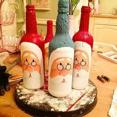 Second stage done on these handpainted win bottles. Glass Bottle Crafts, Wine Bottle Art, Painted Wine Bottles, Diy Bottle, Decorated Bottles, Garrafa Diy, Christmas Wine Bottles, Bottle Painting, Decoration Table