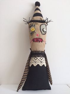 Esmerelda Witch is a OOAK textile art doll with a mismatched fabrics. She has a distressed aged appearance.    She is approx 16 tall