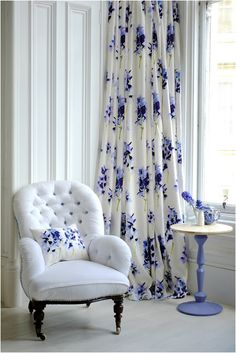 white chair with lovely blue floral curtain