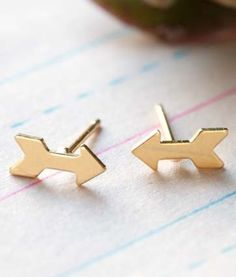 "Tiny Gold Arrow Post Earrings to point the way with a little golden glow.  Charming and sweet measuring only 8mm or just over 1/8"" long, they are made of brass with surgical steel posts and finished with a heavy 24k gold plate."