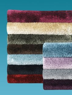 Colored bath rugs make an effortless and functional decorating touch. #AnnasLines #Color