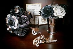 Steampunk paper floral arrangement suite complete with coordinating invitation set on sparkly copper-toned card stock adorned with gears