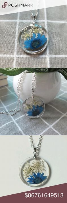 COMING SOON Pressed Flower Pendant A beautiful dried blue daisy with a decoration of baby's breath enclosed in a round resin pendant.   Like to be notified of their arrival. Jewelry Necklaces