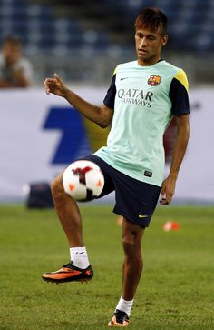 Neymar of Barcelona FC controls the ball during Barcelona FC training session at Bukit Jalil National Stadium on August 9, 2013 in Kuala Lumpur, Malaysia.