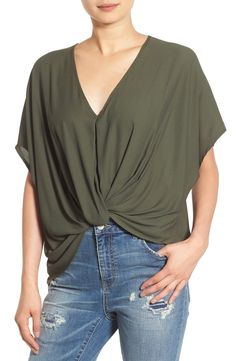 Loving this wardrobe staple from the Nordstrom Anniversary Sale! Elegantly draped folds twist and drape at the front of this V-neck woven top with refined kimono sleeves and a slightly cropped high/low hem.