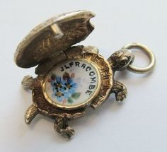 Victorian opening enamel tortoise charm, souvenir from Ilfracombe. www.sandysvintagecharms.com