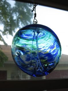 """witch ball"" I have these in every window of my home. Evil spirits go inside but can't find the way out."