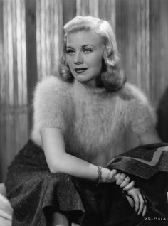 Ginger Rogers in a fluffy angora sweater short sleeves wool skirt hairstyle pageboy 40s era vintage fashion black white photo print ad movie start icon