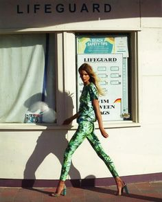 green tropical print pants and top
