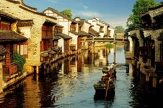 Wuzhen is one of the most famous water towns near Hangzhou. Check here to get the latest travel tips and information about traveling to Wuzhen from Hangzhou. Places Around The World, Oh The Places You'll Go, Places To Visit, Around The Worlds, Hangzhou, Dream Vacations, Vacation Spots, Lago Titicaca Peru, Shanghai