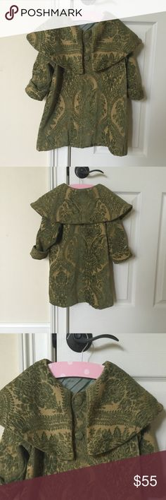 Green with velvet patterned girls brocade coat. Green and velvet patterned brocade coat. Purchased from one of my favorite boutiques in LA named Right Bank Babies. The size tag has been removed but it is a size 4/6. Right Bank Babies Jackets & Coats Capes