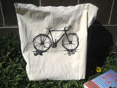 could make this with tote bag from craft store and freezer paper stenciling.