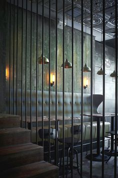Another view of MATTO Bar...shaped and dramatic banquette back with overhead lighting and rustic chairs