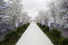 Inside Weddings Spring 2017 issue outdoor wedding ceremony gay wedding LGBT trees along aisle