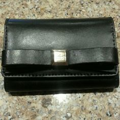 New Kate Spade coin/card holder & key fob This new Kate Spade is like a mini wallet.  Carry I'd, coins,  cash and cards and there is an attached key fob.  Front  has the beautiful black bow; back has place for id.  Great for a small crossbody or by itself on a night on the town.  2nd picture shows size in comparison to a dollar bill. kate spade Bags Clutches & Wristlets