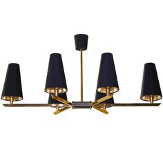 French 1950's Linear Six Light Brass Chandelier   From a unique collection of antique and modern chandeliers and pendants  at https://www.1stdibs.com/furniture/lighting/chandeliers-pendant-lights/