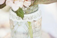 #lace, #mason-jars  Photography: Glass Jar Photography - glassjarphotography.com Wedding Design: A Southern Affair - asouthernaffairevents.com  Read More: http://www.stylemepretty.com/2013/01/23/alabama-backyard-wedding-film-from-glass-jar-photography/