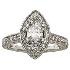 Are you planning a vintage-inspired wedding? You'll need a vintage inspired engagement ring to match! This 1.5ct Marquise Cut Diamond Halo Style Engagement Ring in 14K White Gold from Felt Noir is the perfect fit! This style has a band and center stone that are covered in diamonds and is available in sizes 5 through 9 (half sizes available). Repin to your own wedding inspiration board!