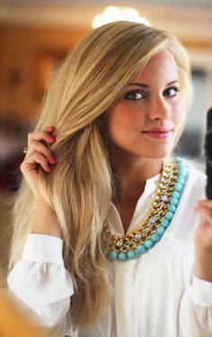 love her white blouse with a statement necklace