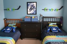 I was recently challenged to redo my boys' shared bedroom, and to incorporate practical (and age appropriate) storage solutions for their things, as well as their individual interests and personalities.