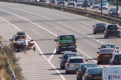 Unbelievable moment man walks #Barefoot to stop Motorway traffic after getting flat tyre. #Drive_Dynamics