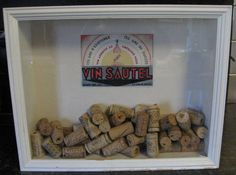 Wine cork collector frame - Write dates and occassions on the cork before dropping it in the shadow box to keep track of special events in a way that's decorative and beautiful!