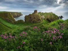 Scotland - This ruined medieval fortress lies on a rocky headland on the north east coast of Scotland. The ruins span over 3.5 acres and are surrounded by steep cliffs that drop into the North Sea.