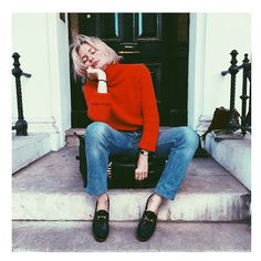 red sweater styled with a simple pair of blue jeans | outfit inspo