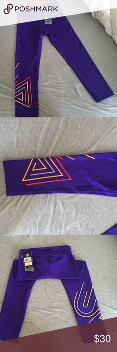 brand new purple Under Armour leggings super cute Under Armour spandex leggings. really pretty deep purple color with design on right leg. never worn and still has tags! make an offer :-) Under Armour Other
