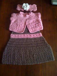 Just Finished this Toddler Dress in Dark Driftwood and Boo Pink with matching Short Sleeve Cardigan Sweater and matching Headband with White Flower.. Selling for $38.50 Plus Shipping and Handling.  Can also be seen on Facebook and Etsy..