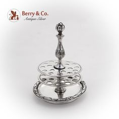 Victorian French 1st Standard 950 sterling silver stick pin holder decorated with the relief leaf & ribbon pattern along the bottom edge. There is also foliate decorations and figural pomegranate finial on the handle. Marked 2901. c. 1880-1900.
