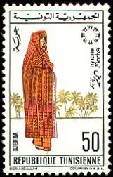 Subject  Montreal International Exhibition (Canada I): Djerba Regional Costume  Number  829  Size  23x37 mm  Issue Date  28/04/1967  Number issued  5000000  Serie  commemorative  Printing process  Helio-engraving  Value  50 millimes  Drawing  Jelal BEN ABDALLAH