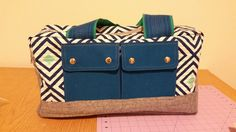 This cargo duffle bag was designed by Noodleheadand published by Robert Kaufman Fabrics. I bought the kit for it because I loved Emmie K's Geo Pop design. It is rated for a level of sewer …