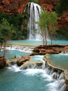 Havasu Falls plunging over majestic red rocks and pooling into milky, turquoise water. Havasu Falls, Grand Canyon National Park, where the waters eventually converge with the mighty Colorado River. Grand Canyon National Park, National Parks, Dream Vacations, Vacation Spots, Parque Nacional Do Grand Canyon, Places To Travel, Places To See, Travel Destinations, Waterfall Hikes