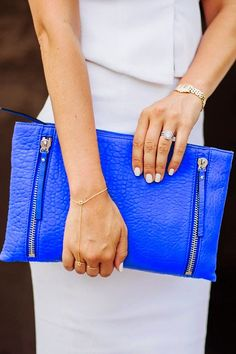 blue twin zip clutch