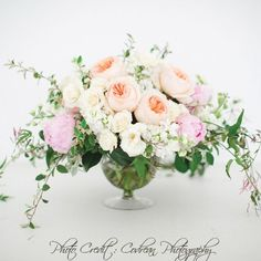 low centerpieces- in mercury compote- similar to this but in ivory, champagne and deep pink- lots of mixed greenery