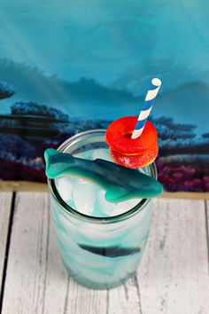 Try making this fun kids shark drink to enjoy while watching all the shark action during shark week. It's also perfect for a shark party or ocean party. Shark Week Drinks, Shark Snacks, Homemade Rice Crispy Treats, Fish Candy, Ice Cream Floats, Blue Food Coloring, Blue Shark, Lime Soda, Bark Recipe