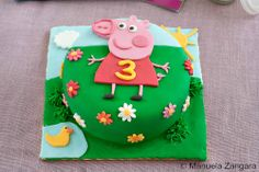 Peppa Pig Cake, I've never used fondant before, but am tempted just for the look on Baylee's face if she had this cake! <3