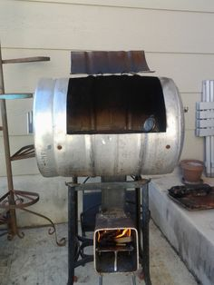 Rocket Stove and Barbeque beer barrel. Got it up to 350 degrees with a peace of split 2x4x6. Fun welding.