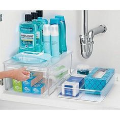 Keep your bathroom cabinets neat and tidy with the InterDesign Bath Organizer Collection. Durable, clear plastic pieces help maximize storage space and offer convenient organization utility in any bathroom. Handy designs also allow convenient portability. Bathroom Organisation, Bathroom Shelves, Home Organization, Bathroom Ideas, Medicine Organization, Bathroom Styling, Organize Bathroom Cabinets, Organizing Bathroom Closet, Storage Ideas For Bathroom