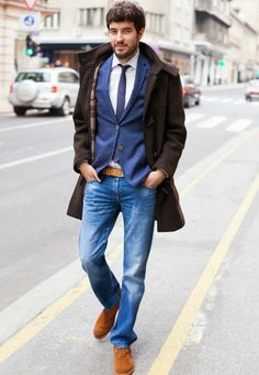 smartly-dressed bearded man, with brown coat, distressed jeans and blue blazer, white shirt and dark blue tie, business casual men