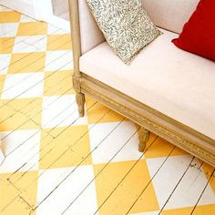 Paint a distressed wooden floor with yellow and white check pattern