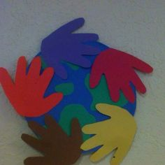 Hands in red, yellow, black and white Jesus Loves the Little Children of the World