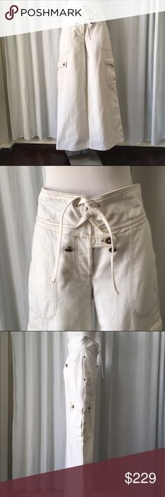 """Alexander McQueen off white denim cargo pants 44 Alexander Mc Queen off white denim wide leg cargo pants , high waist, brown stitching, size 44 some stains at the bottom please check pictures  Measurements  Waist 16"""" Flat  Inseam 33"""" Bottom width 13"""" Hips 22""""  Great conditions dry cleaned. Alexander MC Queen Pants Wide Leg"""