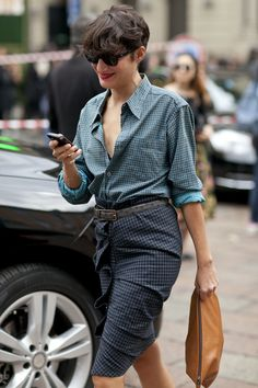 Even the most professional button-down shirts appear lax when you roll up your sleeves. This small styling trick is a great way to give a classic top a little bit of cool-girl feel.