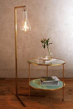 Replace existing floor lamps with gold or cooper lamps.