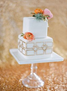 Gold and white two-tiered fondant cake | Photography By / http://josevillaphoto.com