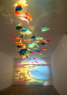 """Looking at two cities from one point of view"", Rashad Alakbarov, Acrylic paper planes and projected light"