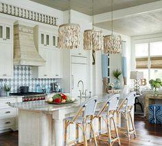 Oyster Shell Chandeliers over Kitchen Island: http://beachblissliving.com/elegant-beach-house-decor-gci-design/